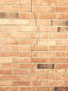 Settling cracks can be indicative of foundation issues, grading issues, or sometimes both.