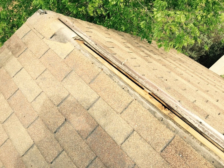 The ridge vent has flown off and has left a wide gap where the storm water is penetrating and going into the house.